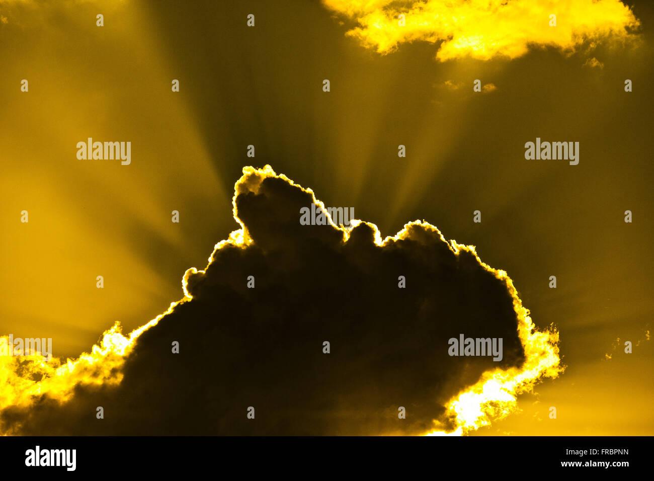 Rain cloud and sunset - Stock Image