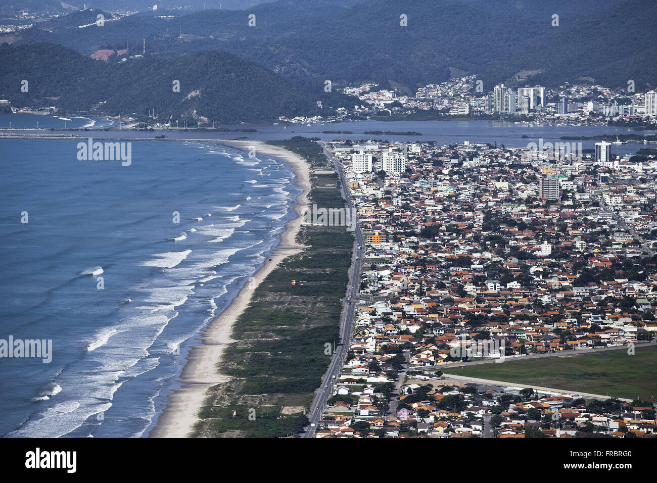 Aerial view of the seafront town with the mouth of the Itajai-Acu River in the background - Vale do Itajai - Stock Image