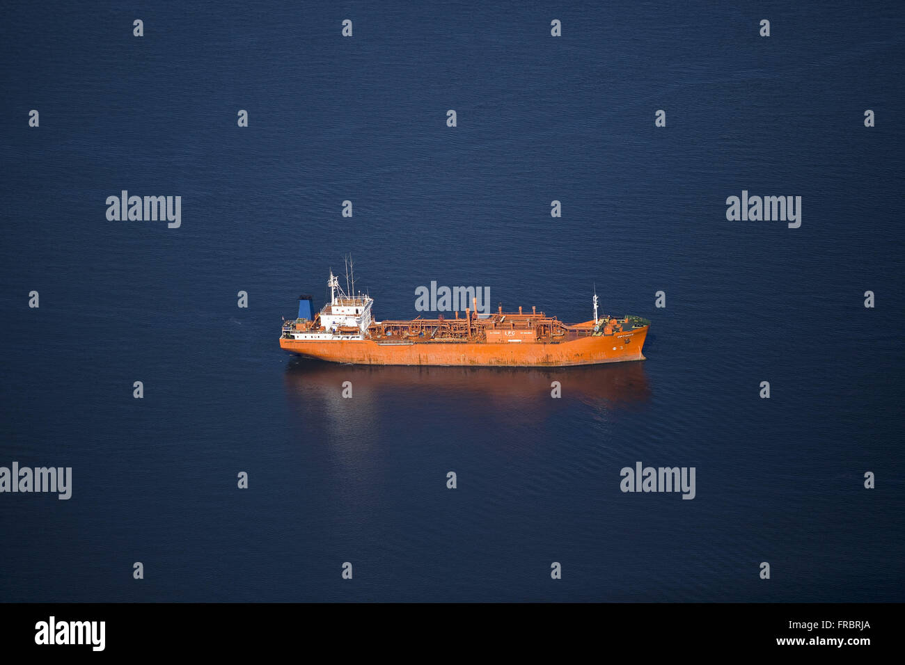 Aerial view of boat anchored next to the harbor in the island municipality Baia Babitonga - Stock Image