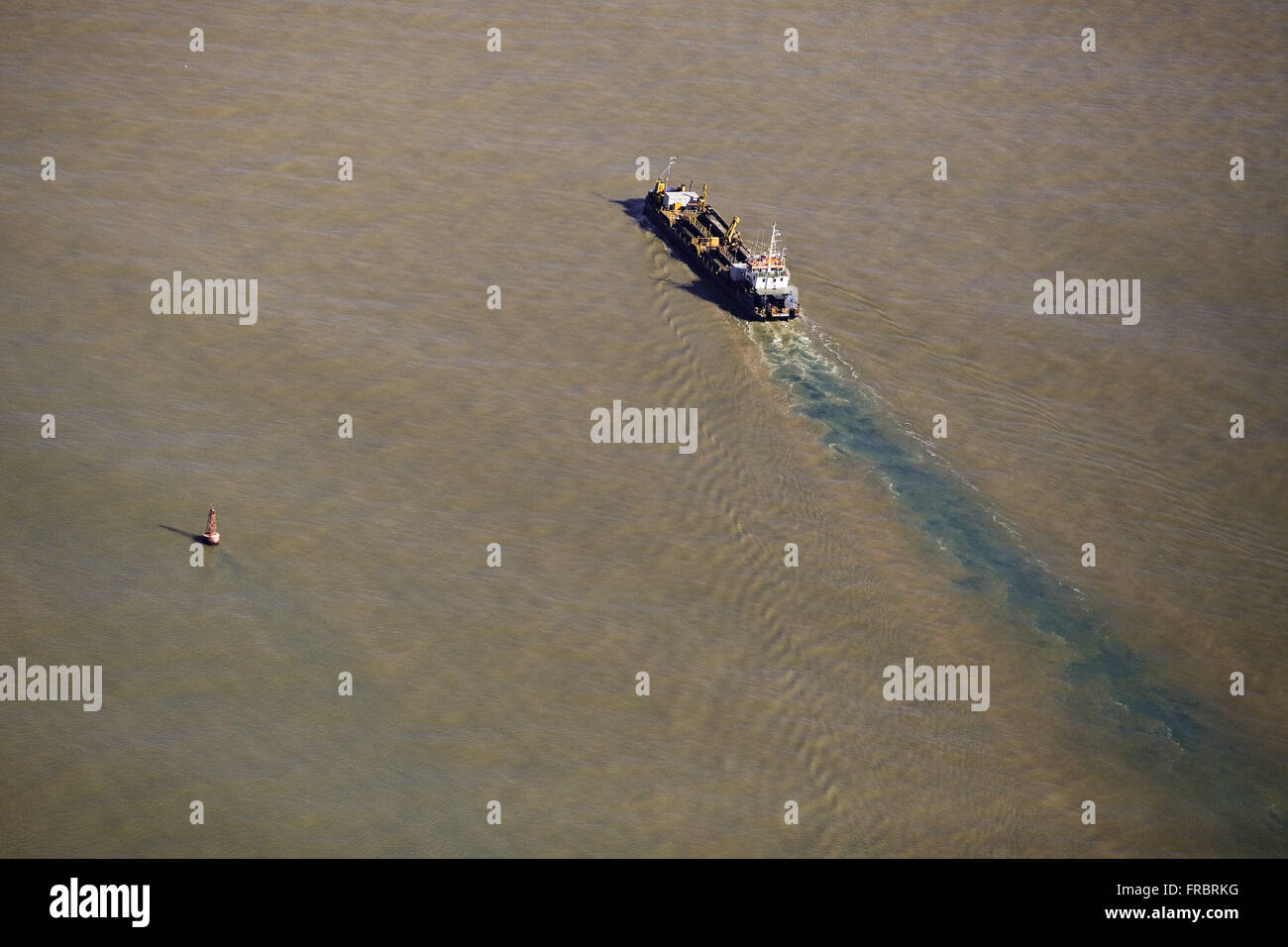 Aerial view of cargo ship entering the Itajai-Acu River - Stock Image