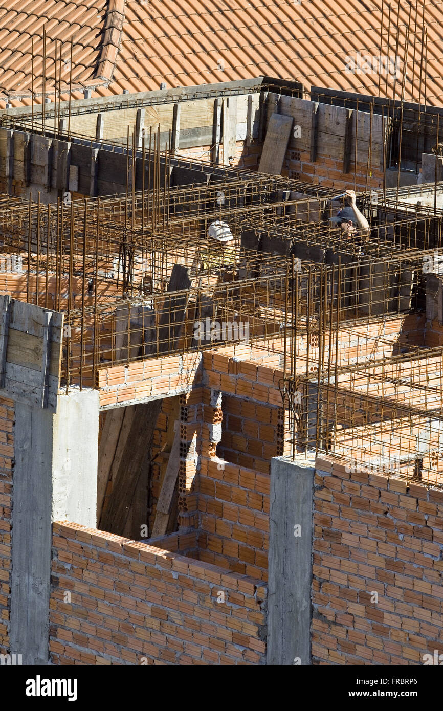 Beams and construction worker - Stock Image