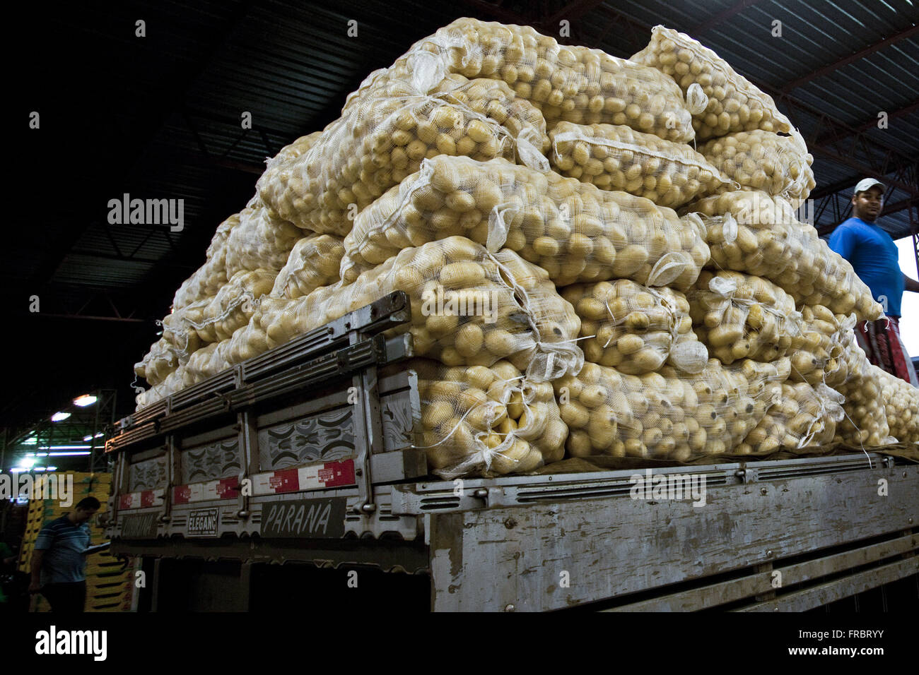 Body of truck loaded with sacks of potatoes in Ceasa overnight - Stock Image