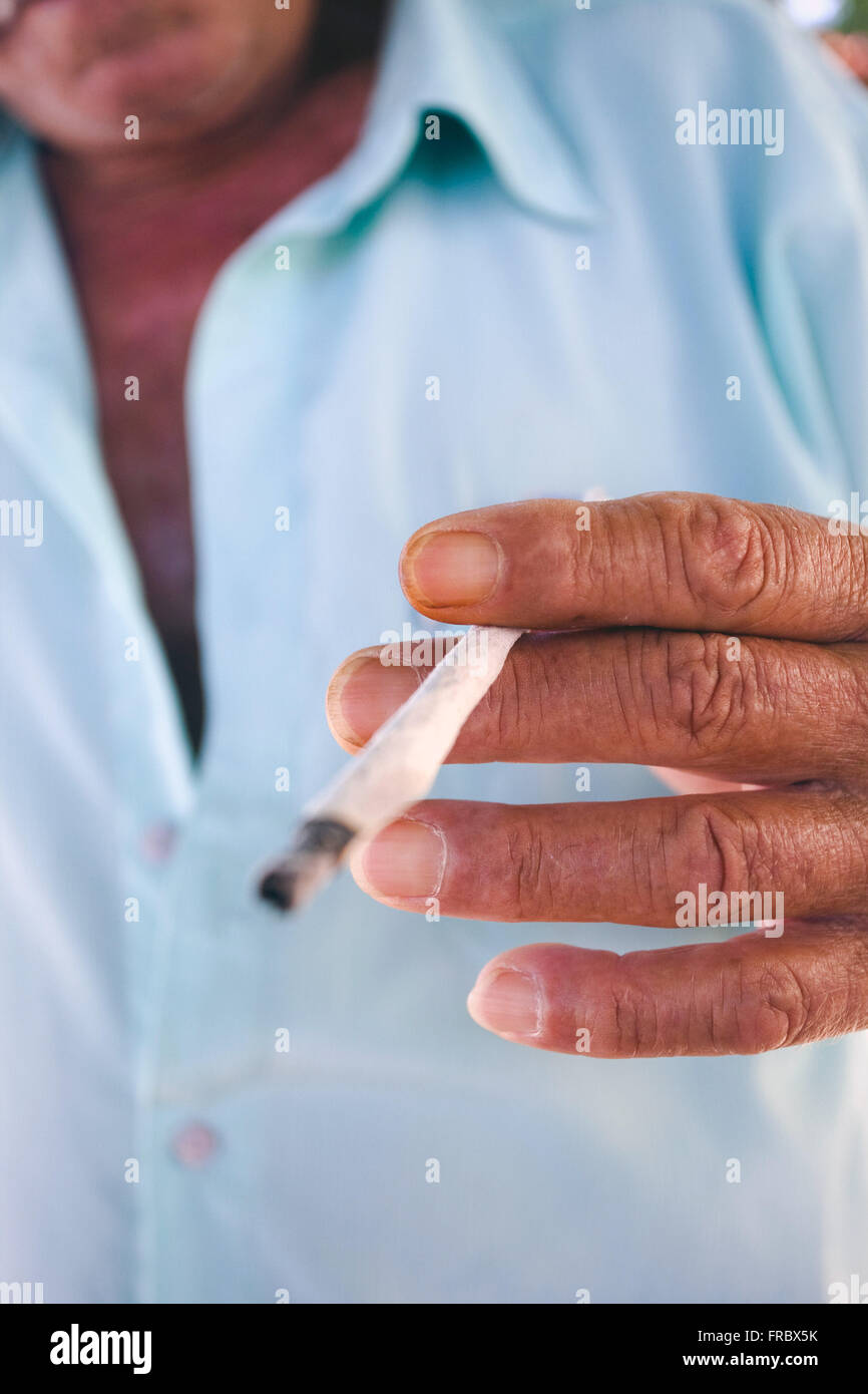 Old smoking cigarette crafted - Stock Image