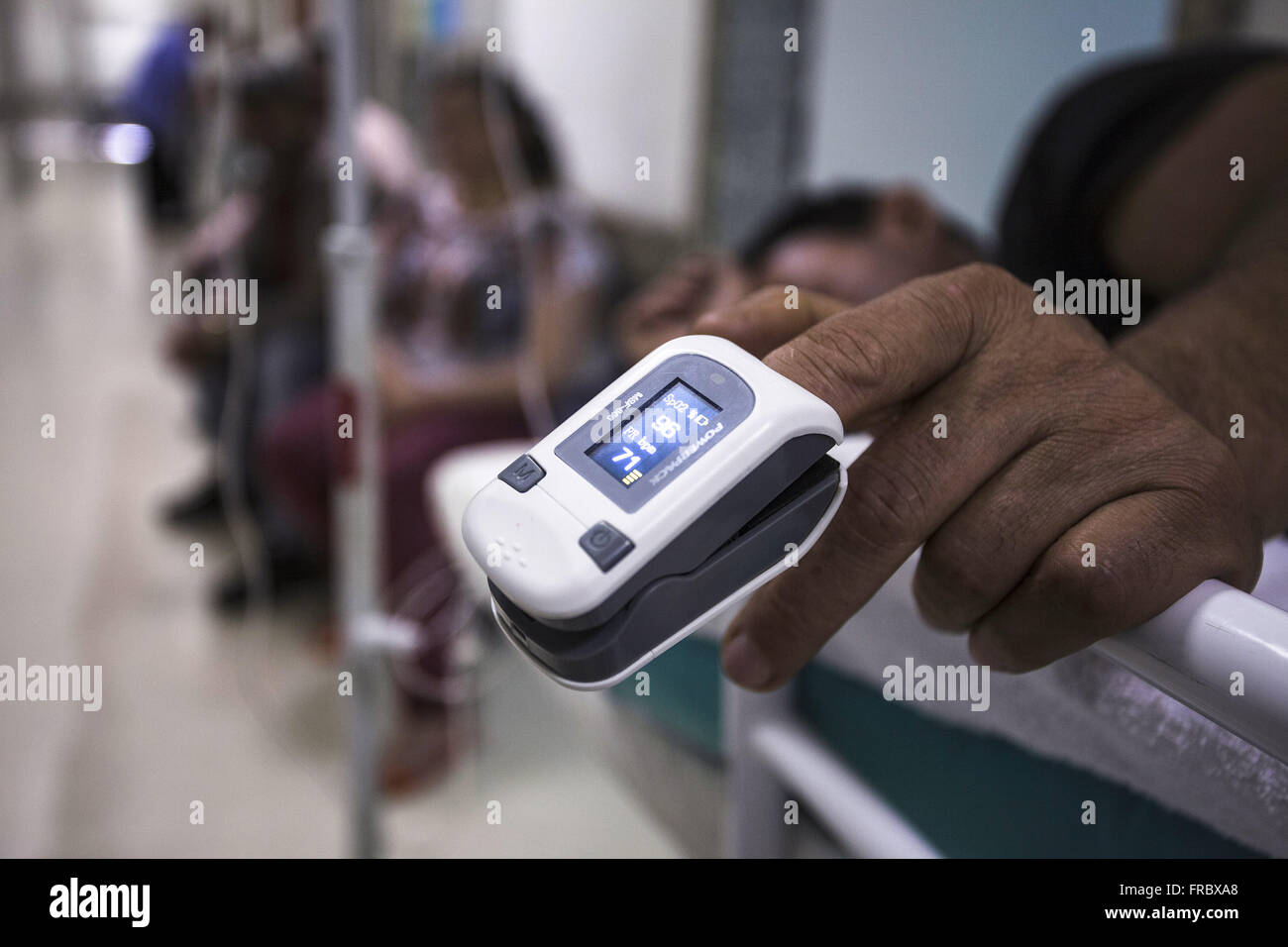 Pulse oximetry in a patient in the hallway of the emergency room at university public hospital - Stock Image