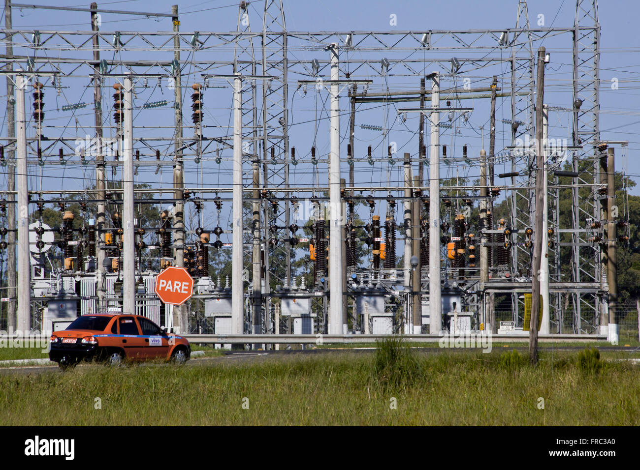 Automobile traveling at next street power substation city - Stock Image