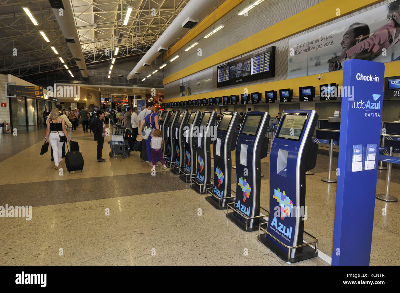 Passengers in the terminal check-in area of Guarulhos International Airport - Stock Image