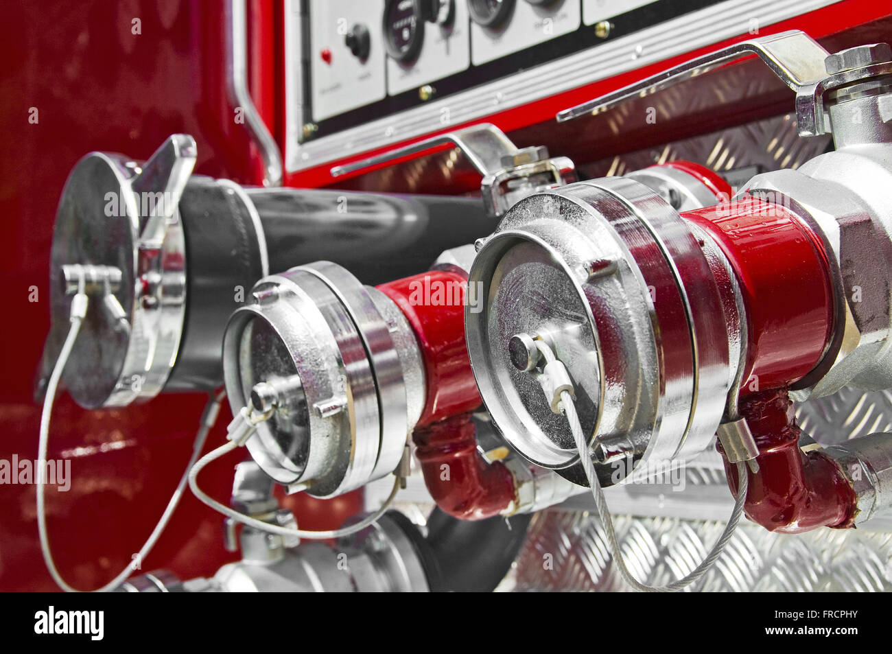 Detail of valves which are attached the hoses in fire truck - Stock Image