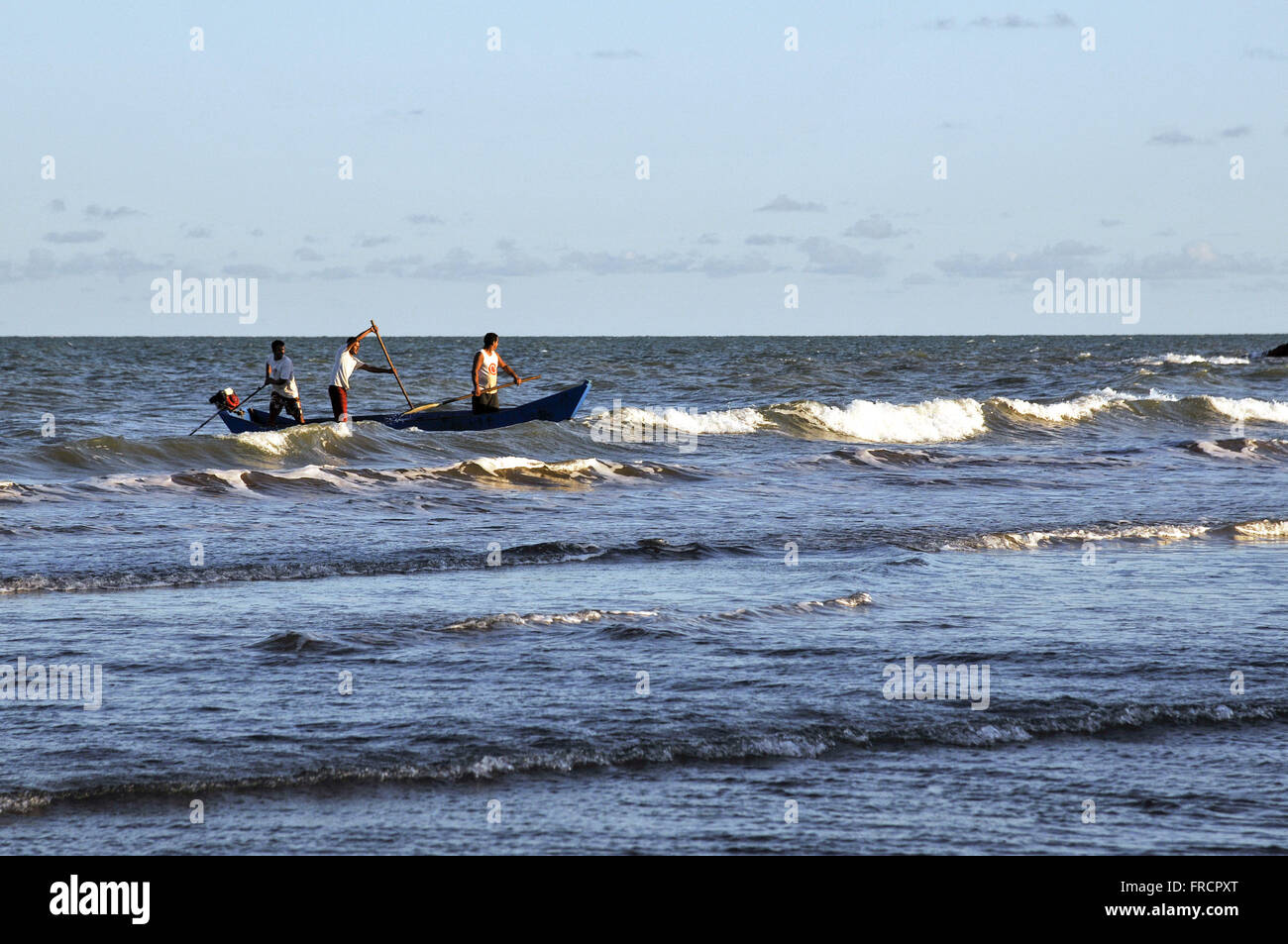Fishermen returning from fishing at dusk on the beach of the village of Itaunas - State Park Itaunas - Stock Image