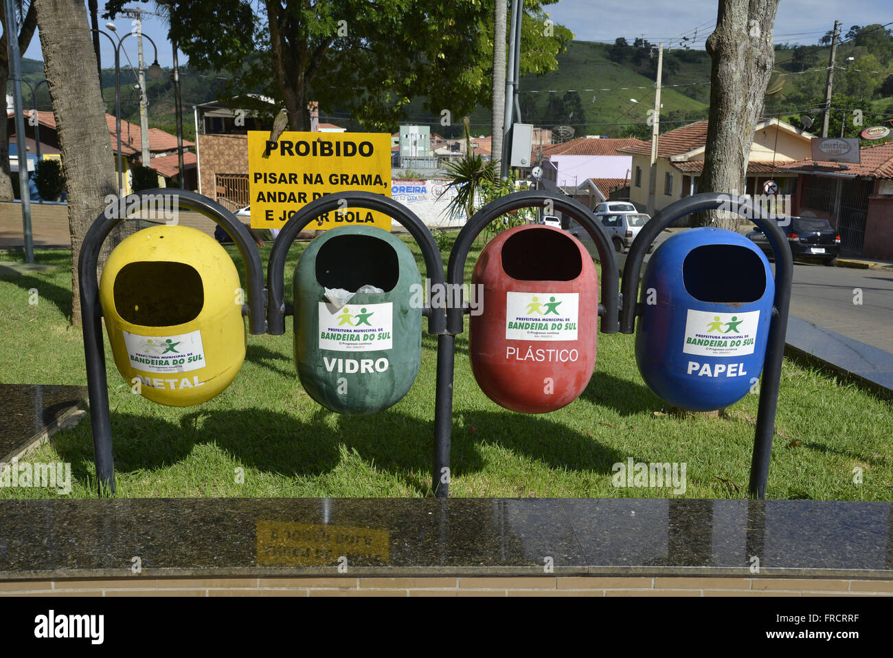 Trash cans for garbage separation discarded in the city center - Stock Image