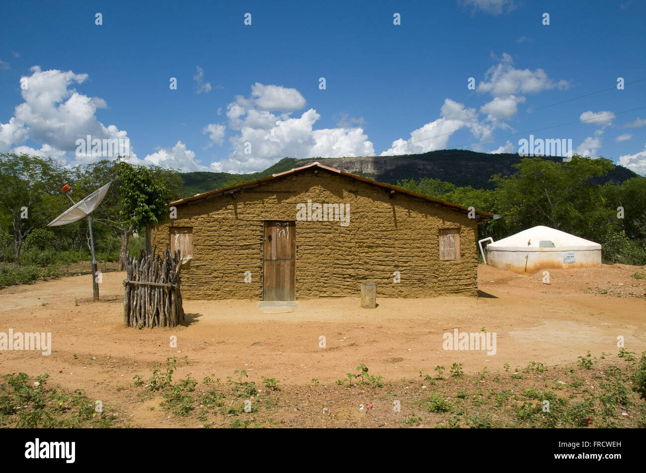 Typical dwelling of the semiarid northeast with tank - Stock Image