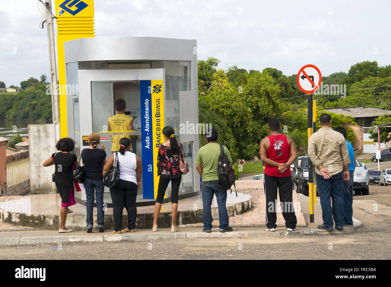 Queue for ATM in Boa Vista - Stock Image