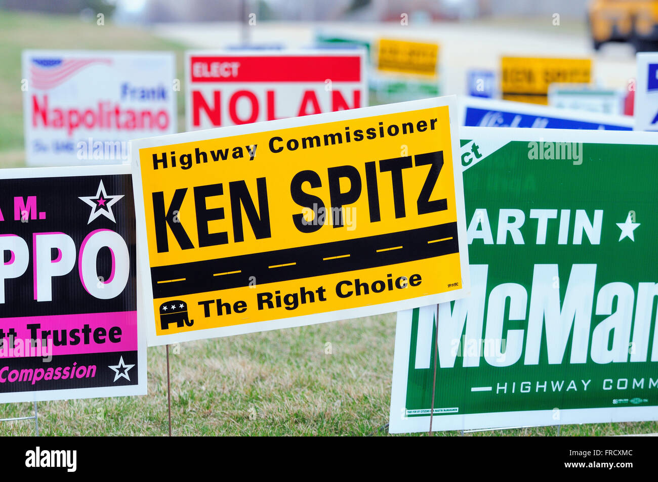 Candidate signs in abundance near a polling place during local elections. Bartlett, Illinois, USA. - Stock Image