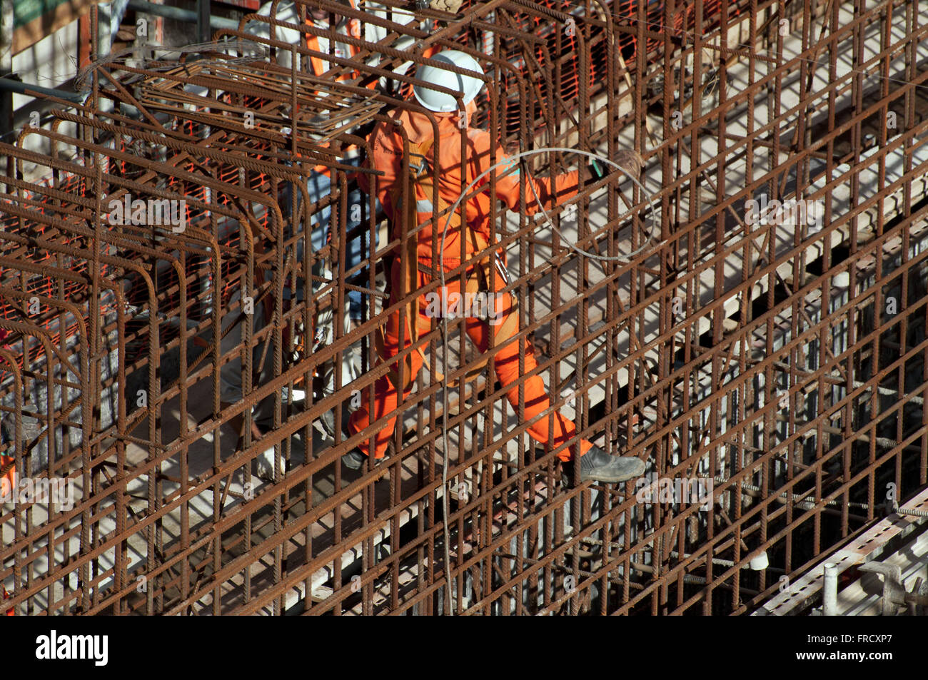 Laborer in the midst of the hardware construction of UBV 2 - pumping unit - lot 9 - Stock Image