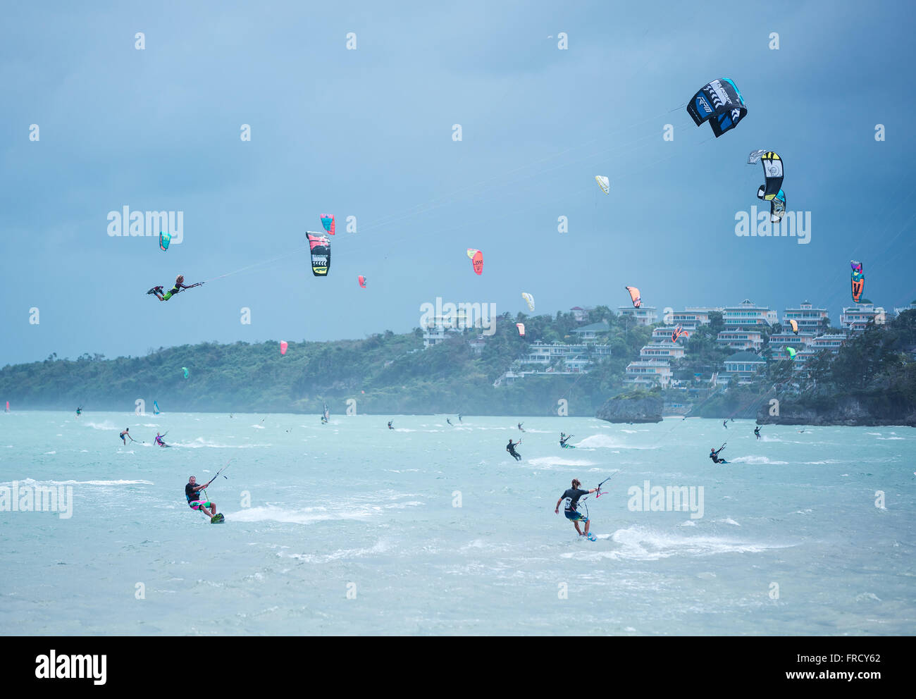 Boracay island, Philippines - January 25: kitesurfers enjoying wind power on Bulabog beach. - Stock Image