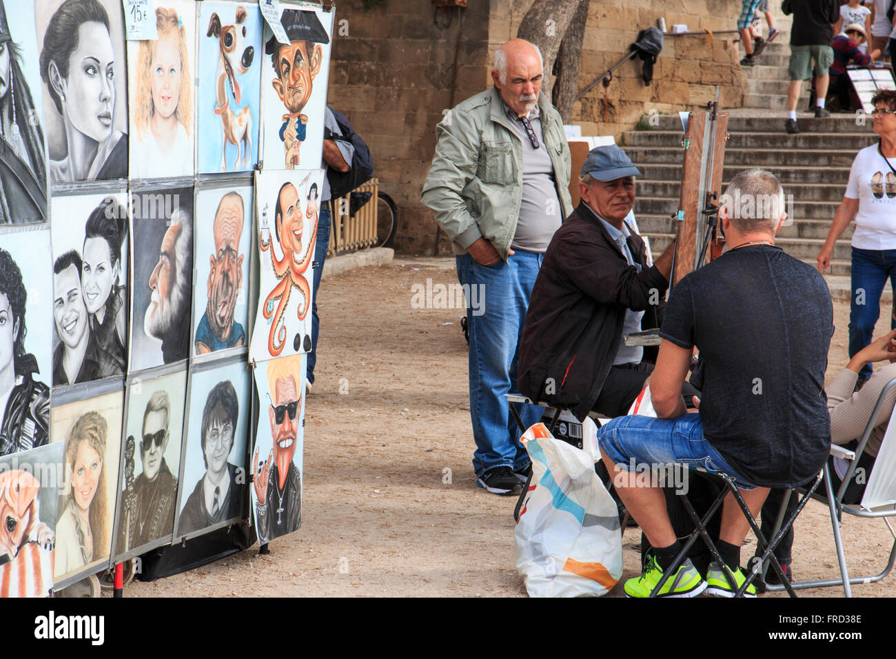 Europe, Spain, Balearic Islands, Mallorca, Palma de Mallorca, street artist paints portraits and caricatures. - Stock Image