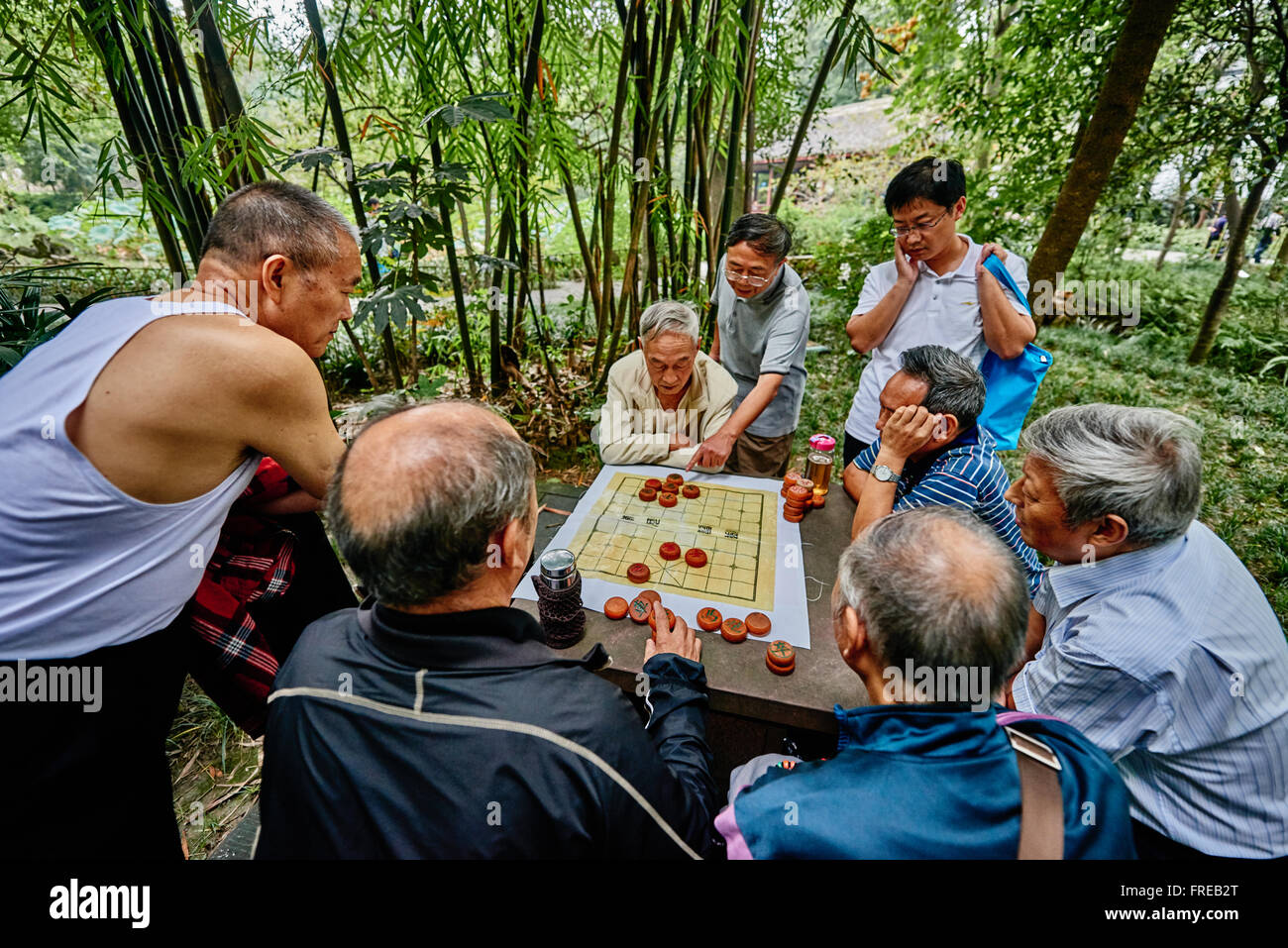 Chengdu, China - September 21, 2014: people playing Xiangqi  chinese chess  Du Fu thatched Cottage park  in Chengdu - Stock Image