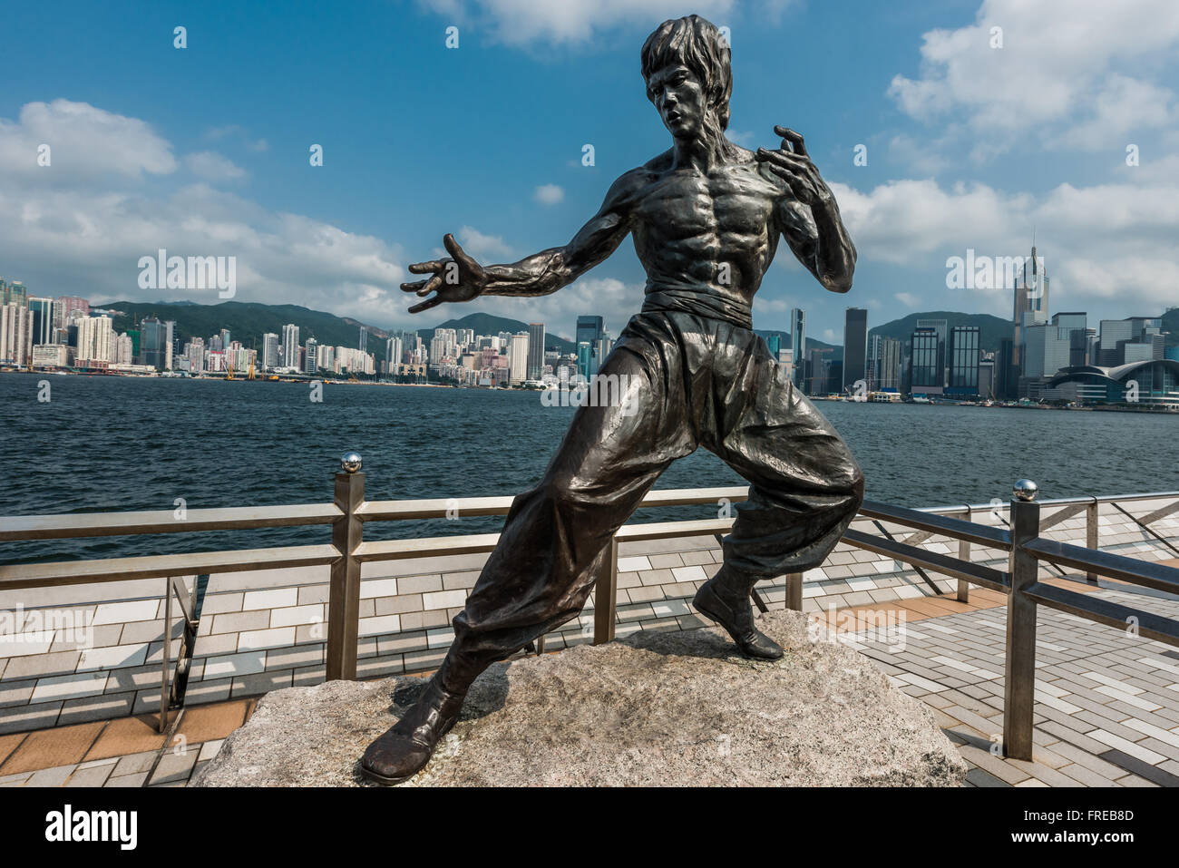 Bruce Lee statue Avenue of Stars Tsim Sha Tsui Kowloon in Hong Kong - Stock Image