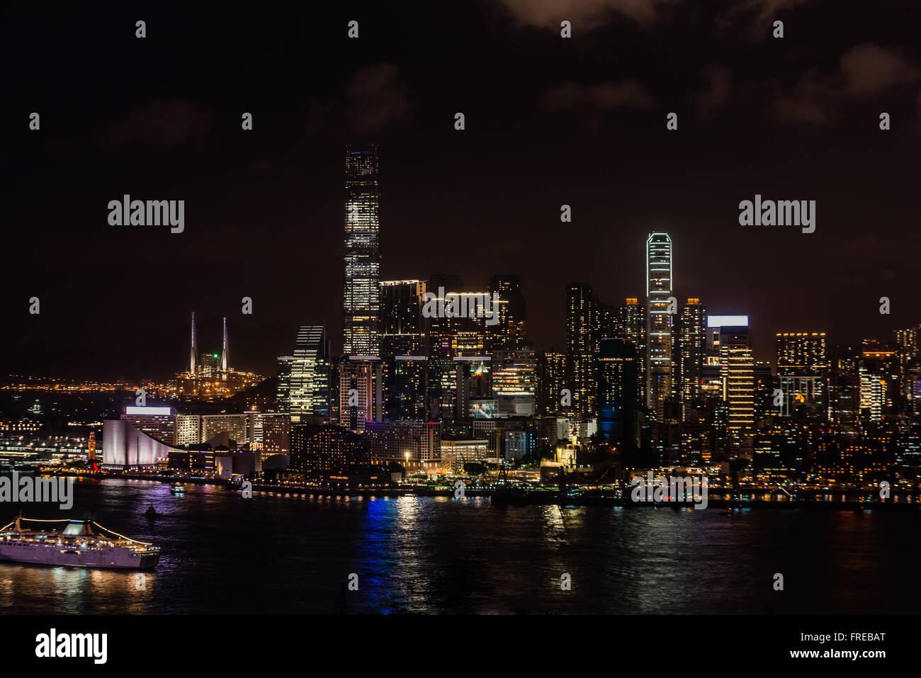 cityscape at night on Tsim Sha Tsui in Hong Kong - Stock Image