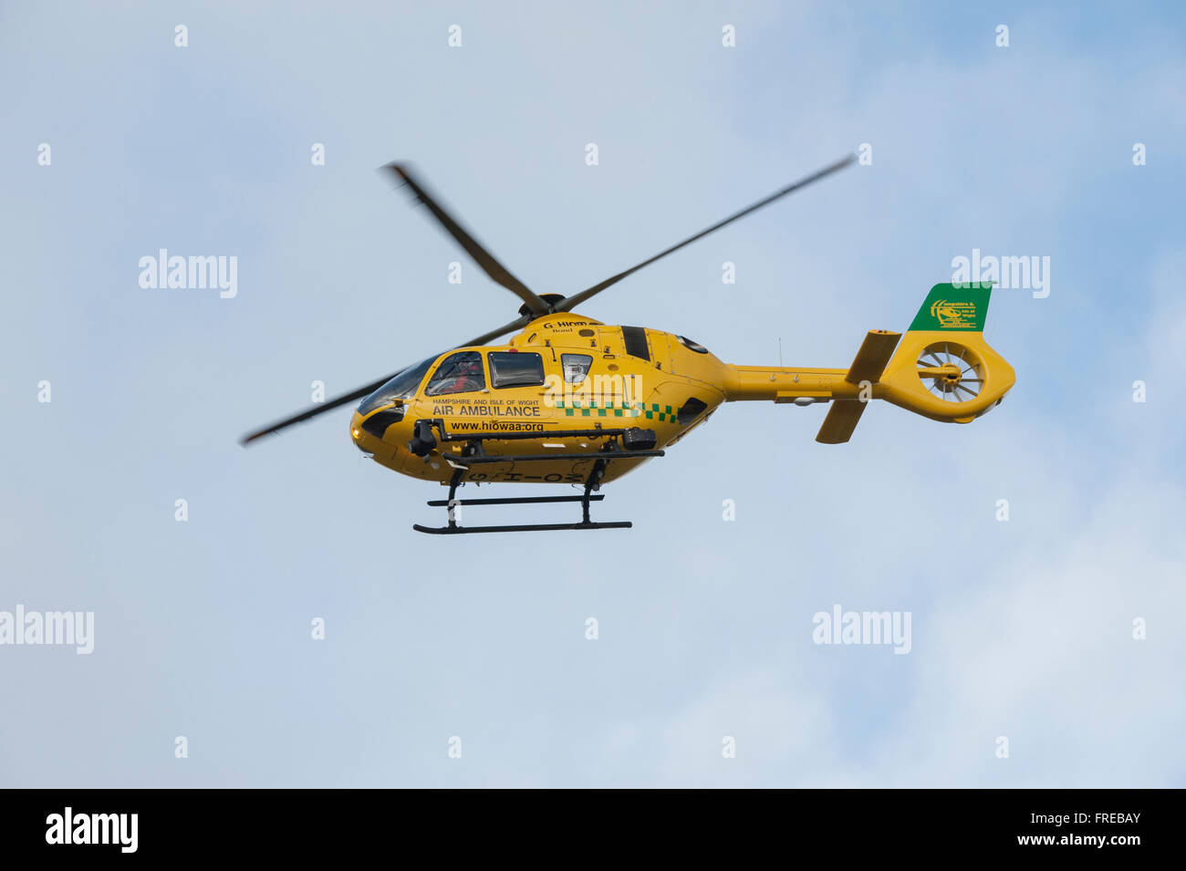 Hampshire and Isle of Wight Air Ambulance in flight - Stock Image