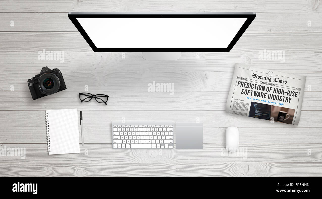 isolated computer display for mockup on work desk with keyboard