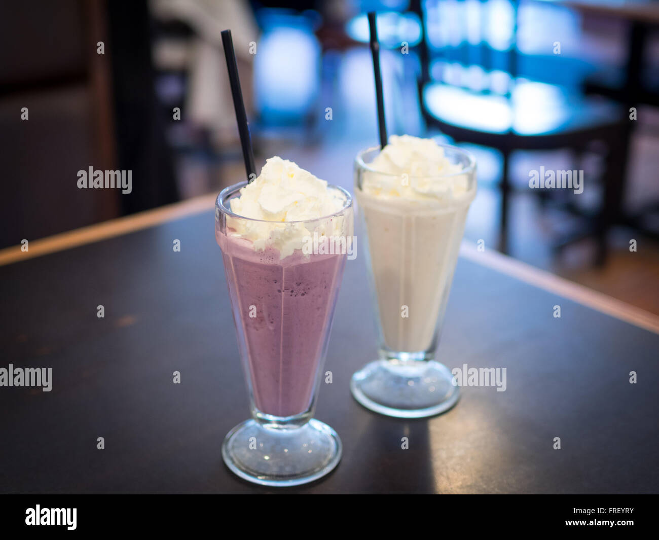 A mixed berry milkshake and chai tea milkshake from Urban Diner in Edmonton, Alberta, Canada. - Stock Image