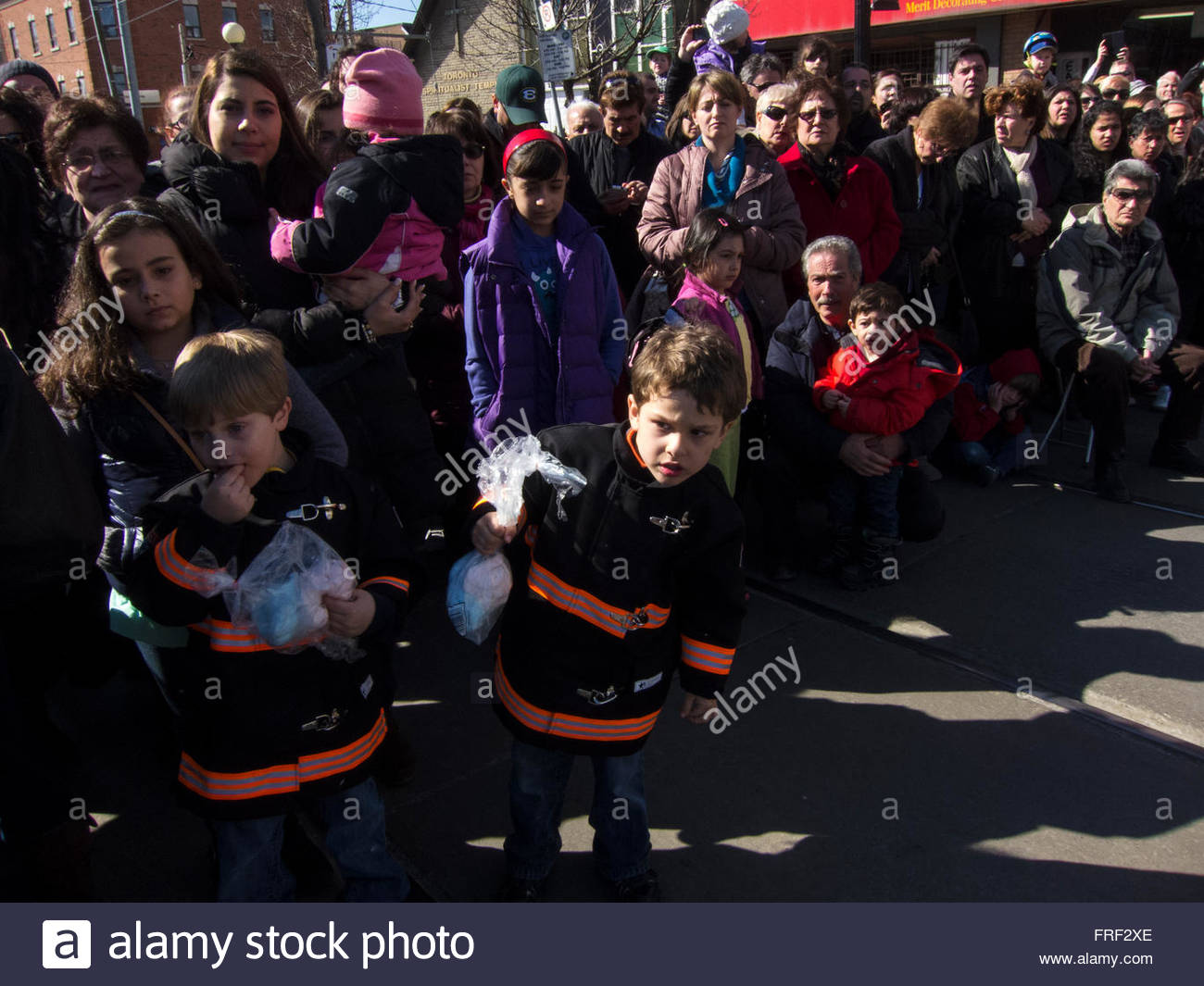 Disturbed looking children watch Jesus flagellation, Easter, Stations of the Cross, Good Friday Parade, 2013 Toronto, - Stock Image