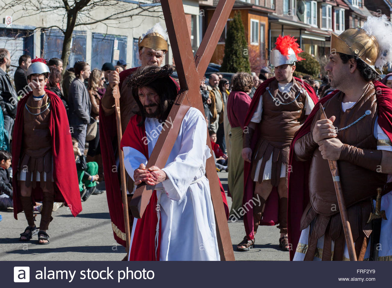 Jesus carrying the cross surrounded by Roman soldiers, Easter, Stations of the Cross, Good Friday Parade, Little - Stock Image