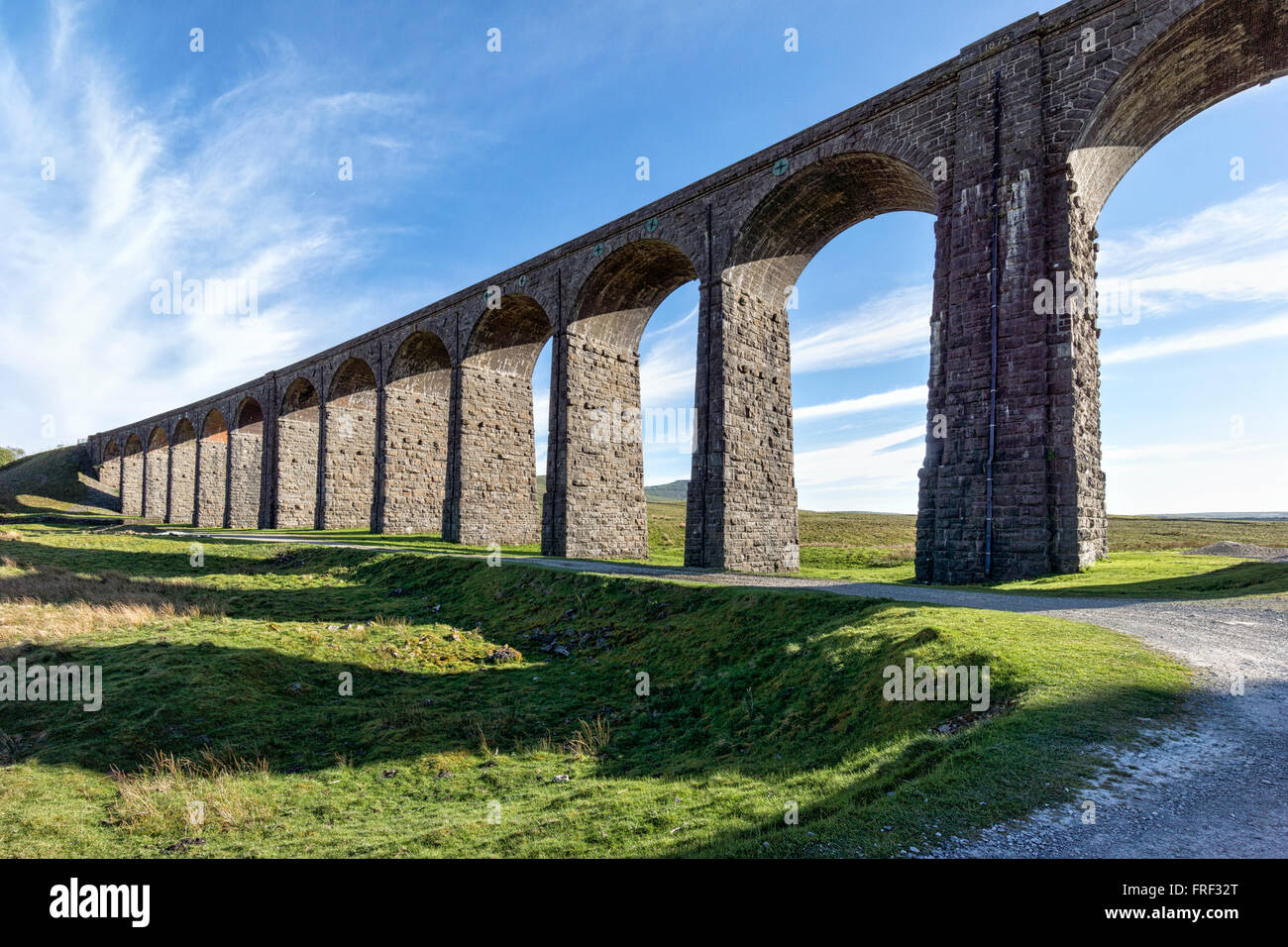 Still in use and recently renovated. The Ribblehead Viaduct or Batty Moss Viaduct carries the Settle-Carlisle Railway - Stock Image