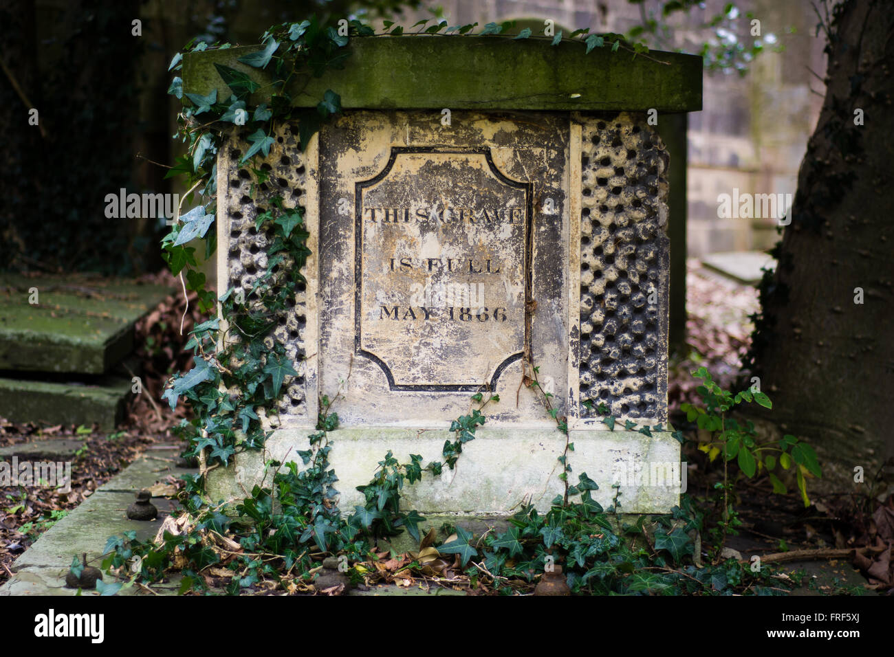 'This Grave is Full' inscribed on a tomb. Unusual wording on the side of a grave, written in 1866, in a - Stock Image