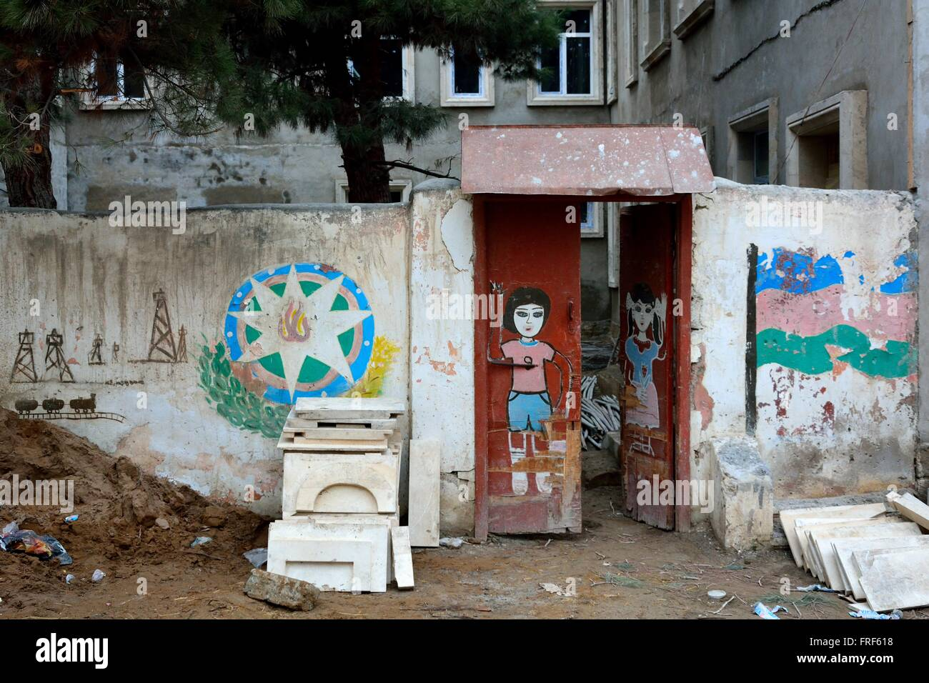 Street art on wall in Baku, capital of Azerbaijan. The Azerbaijani flag, as well as people, have been painted on - Stock Image