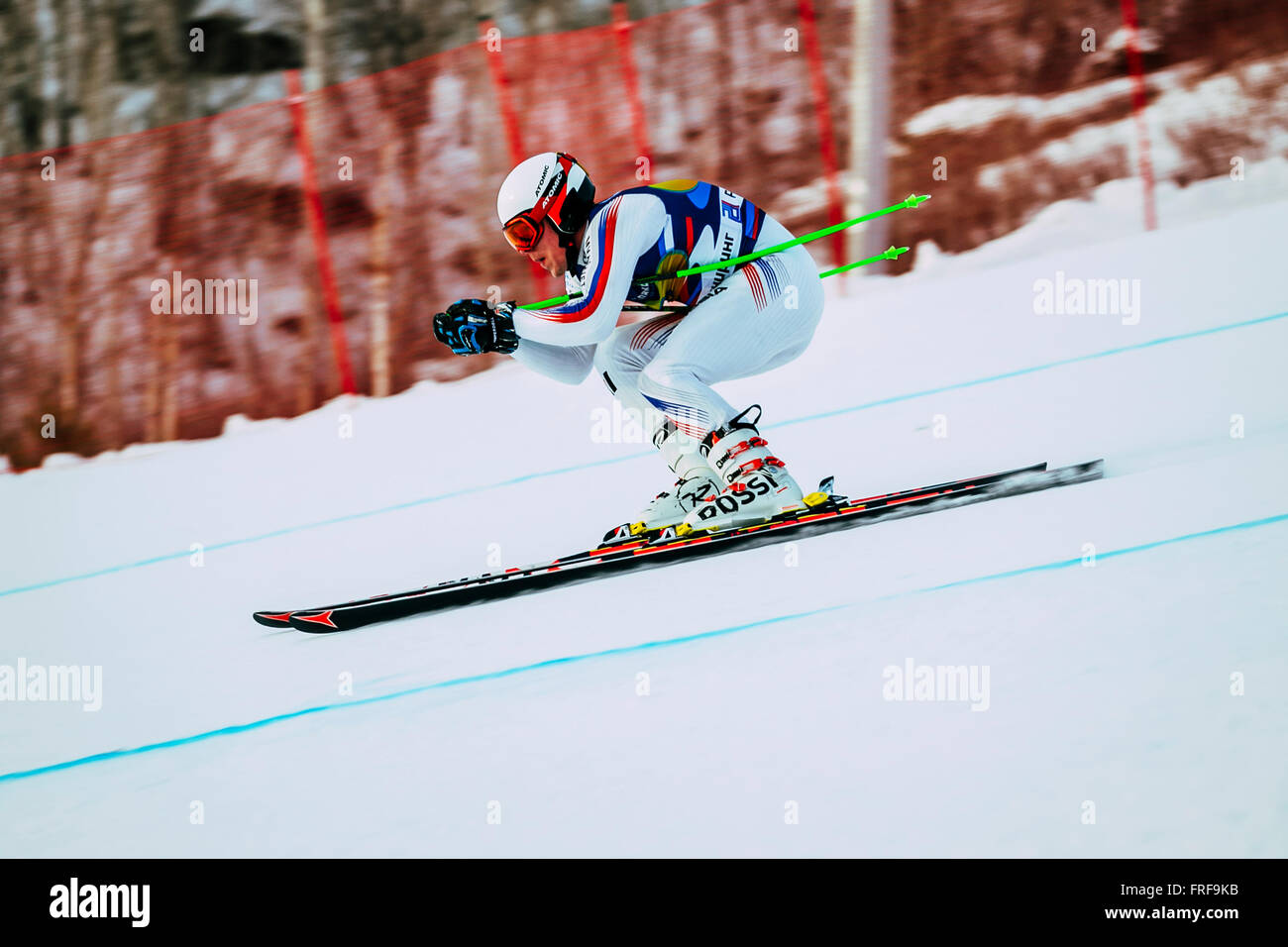 downhill racer young men in competition Russian Cup in alpine skiing - Stock Image