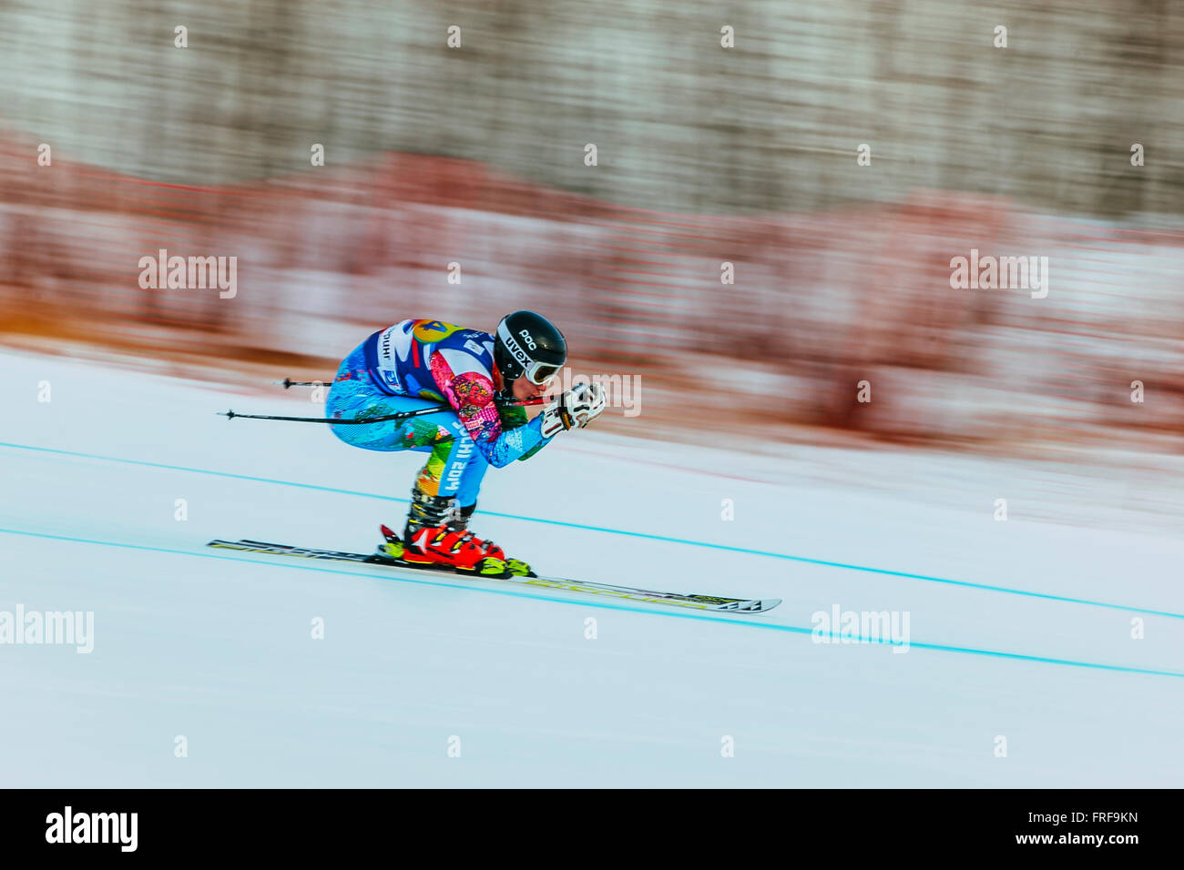 downhill racer young woman in competition. background blur effect during Russian Cup in alpine skiing - Stock Image