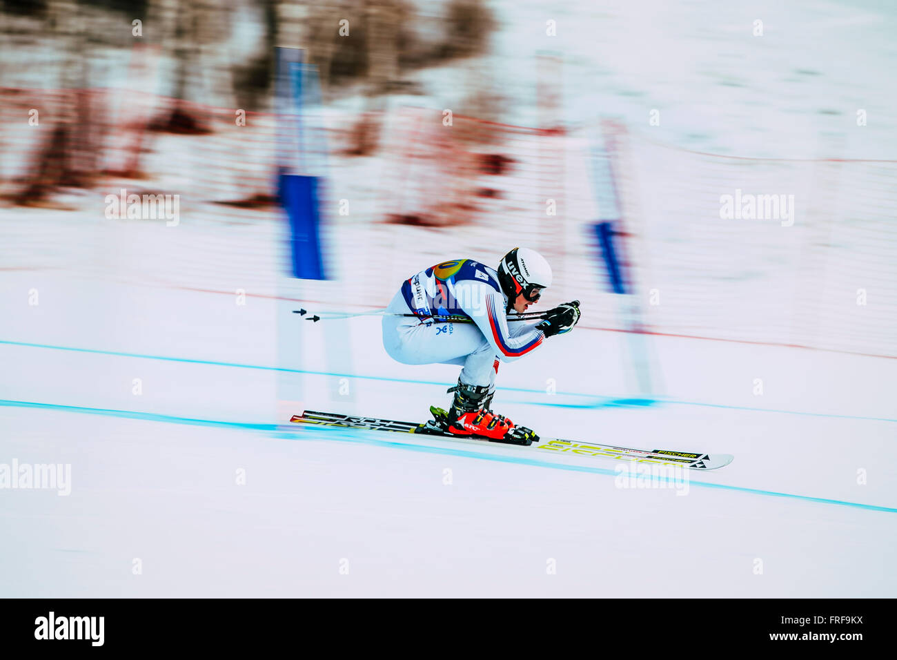 downhill young girl athlete skiing to competition Russian Cup in alpine skiing. background blur effect - Stock Image