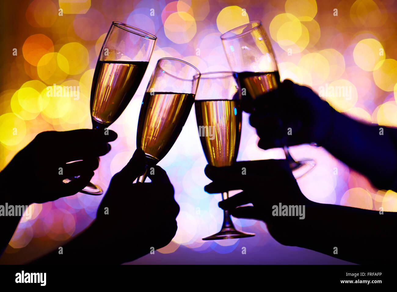 Toasting with champagne - Stock Image