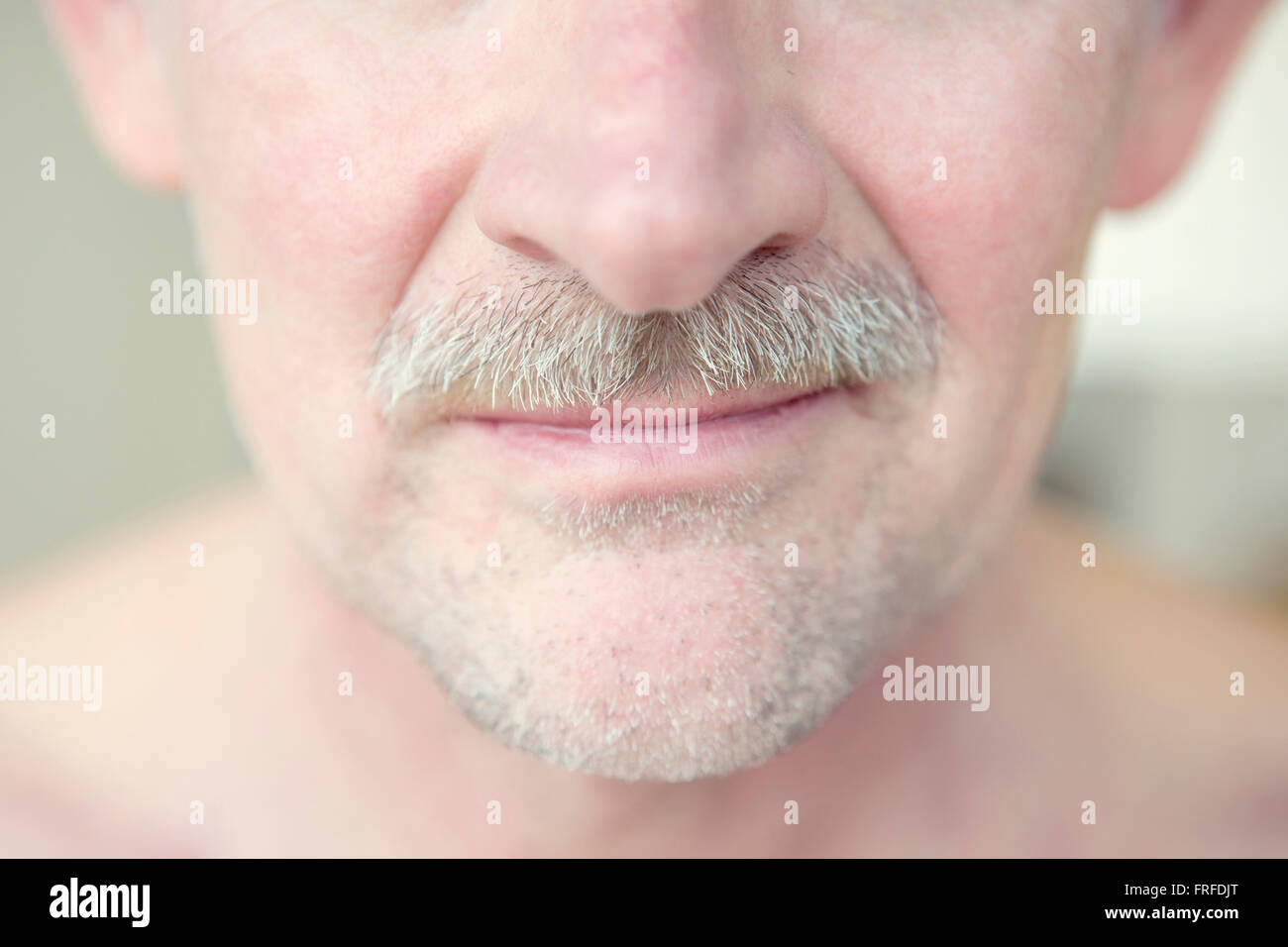 close-up of mature man with grey moustache - Stock Image