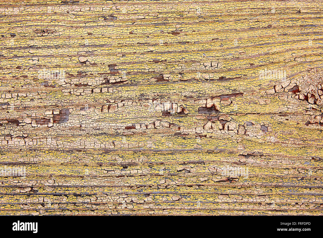 Wood texture with painting color peeled off. Flaking yellow paint ...
