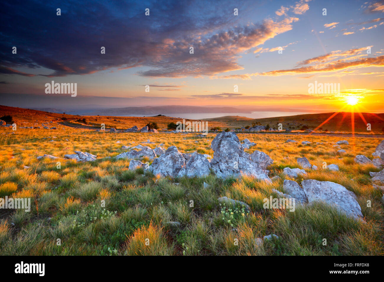 Sunset mountain landscape, View to island Krk from Velebit in Croatia. - Stock Image
