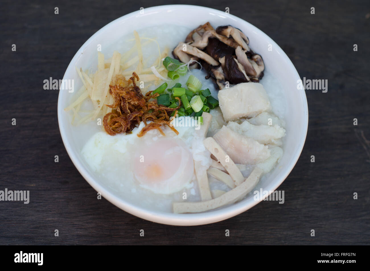 rice gruel with fish and egg mixed - Stock Image