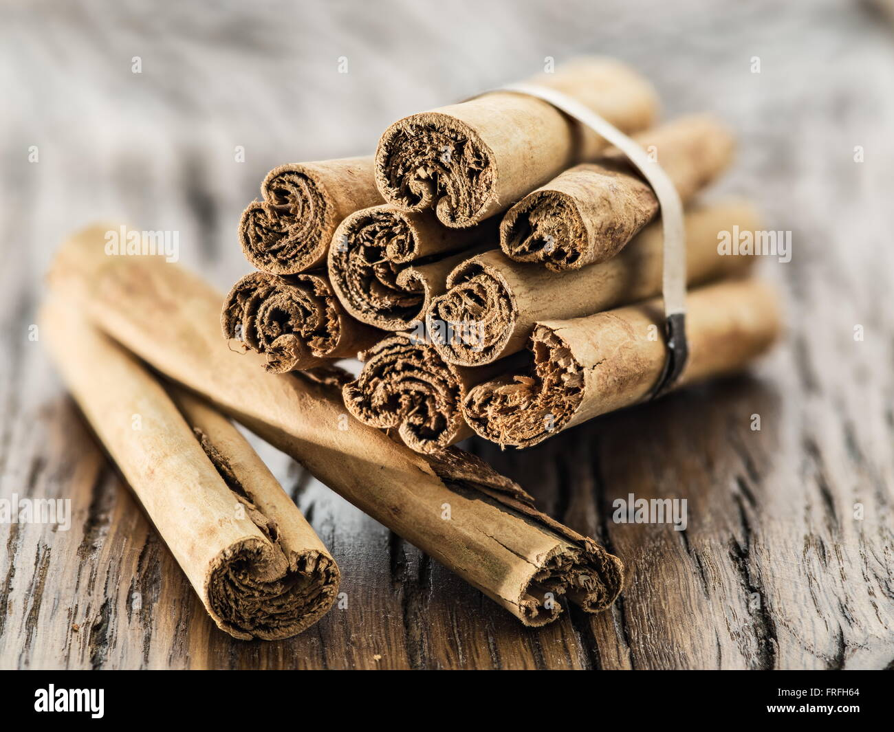 Cinnamon sticks on the wooden table. Close up. - Stock Image
