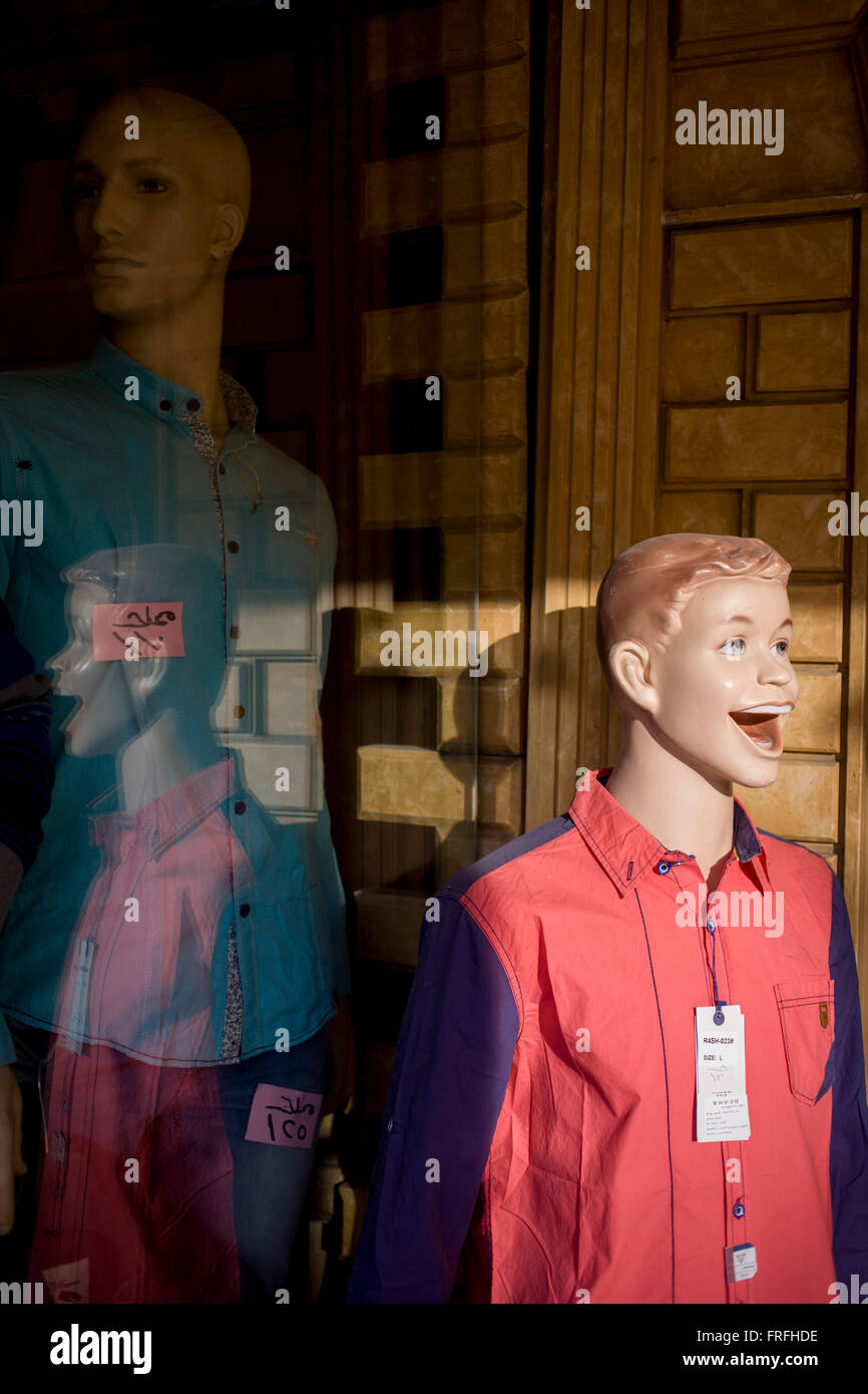 Mannequins in the window of a clothing business displaying Stock
