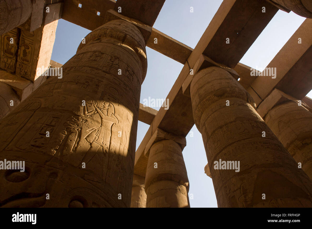 The tall columns in the Hypostyle hall at the Temple of Amun at Karnak, Luxor, Nile Valley, Egypt. The Karnak Temple - Stock Image