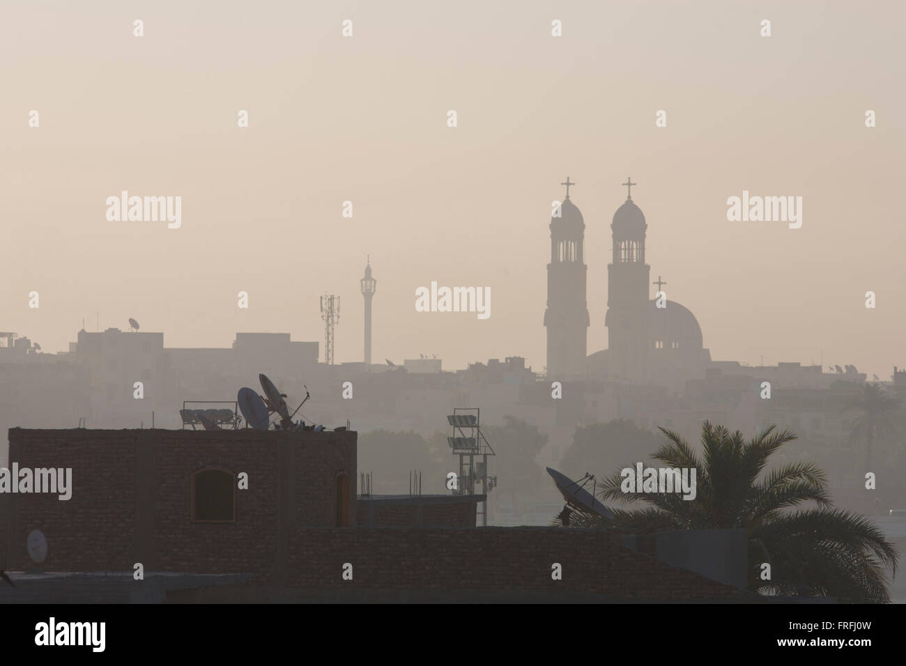 Looking East from the West Bank, early light over the River Nile and city of Luxor with its twin spires of the Christian Stock Photo