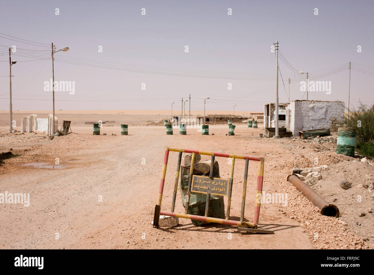 A remote police roadblock landscape near Bagdad, Kharga Oasis, Western Desert, Egypt. The desert lies in the New - Stock Image