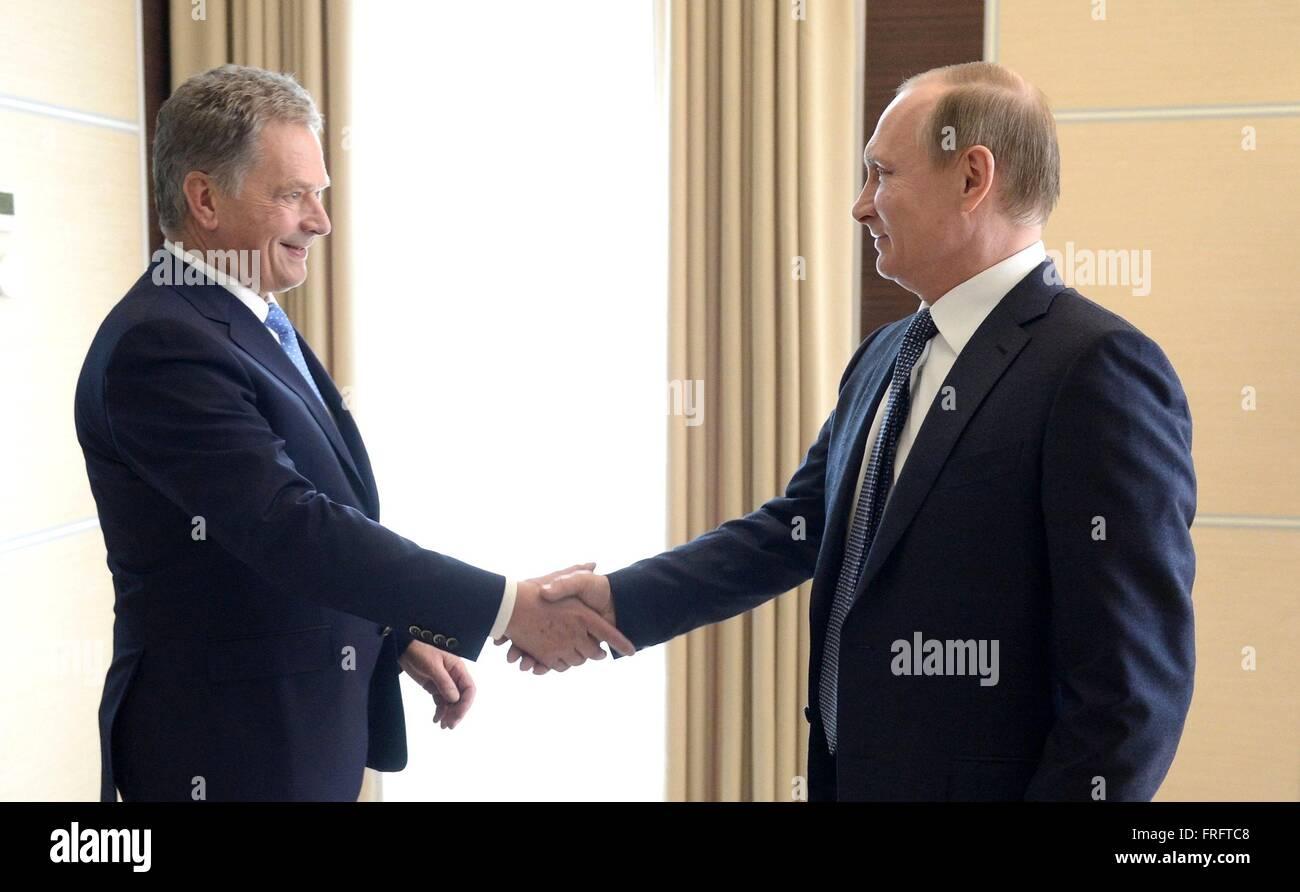 Russian President Vladimir Putin greets Finnish President Sauli Niinisto before a bilateral meeting at Novo-Ogaryovo - Stock Image