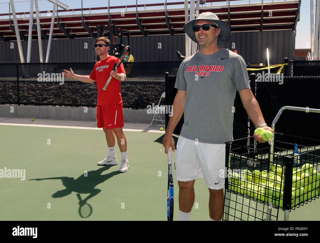 Albuquerque, NM, USA. 22nd Mar, 2016. UNM's Mens tennis Coach Bart Scott(right) and asst. coach Ben Dunbar watch - Stock Image