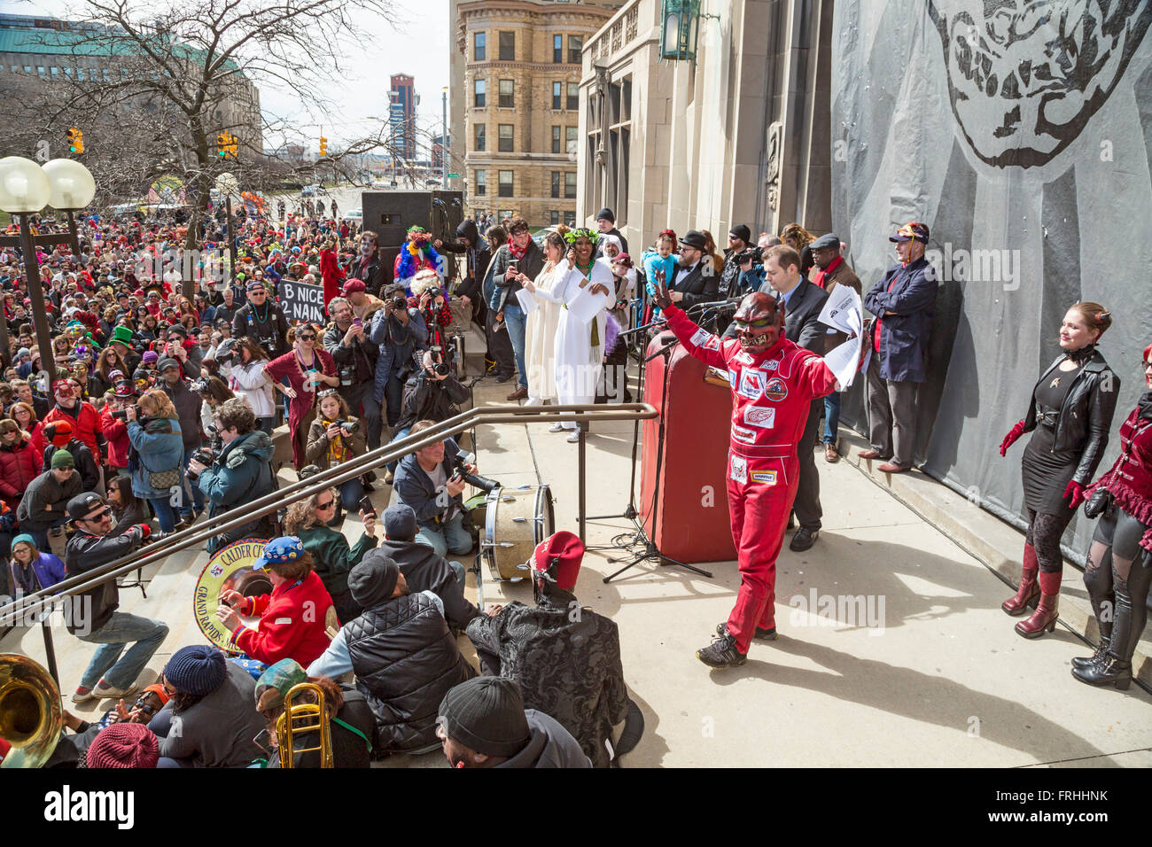 Detroit, Michigan -The Marche du Nain Rouge celebrates the coming of spring and banishes the Nain Rouge (Red Dwarf) - Stock Image