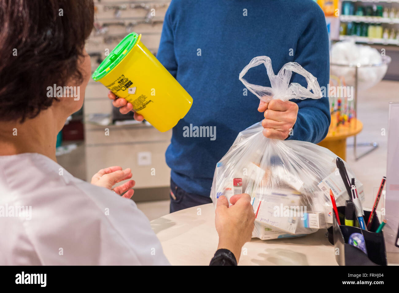 Collection of unused drugs and contaminated sharps disposal. - Stock Image