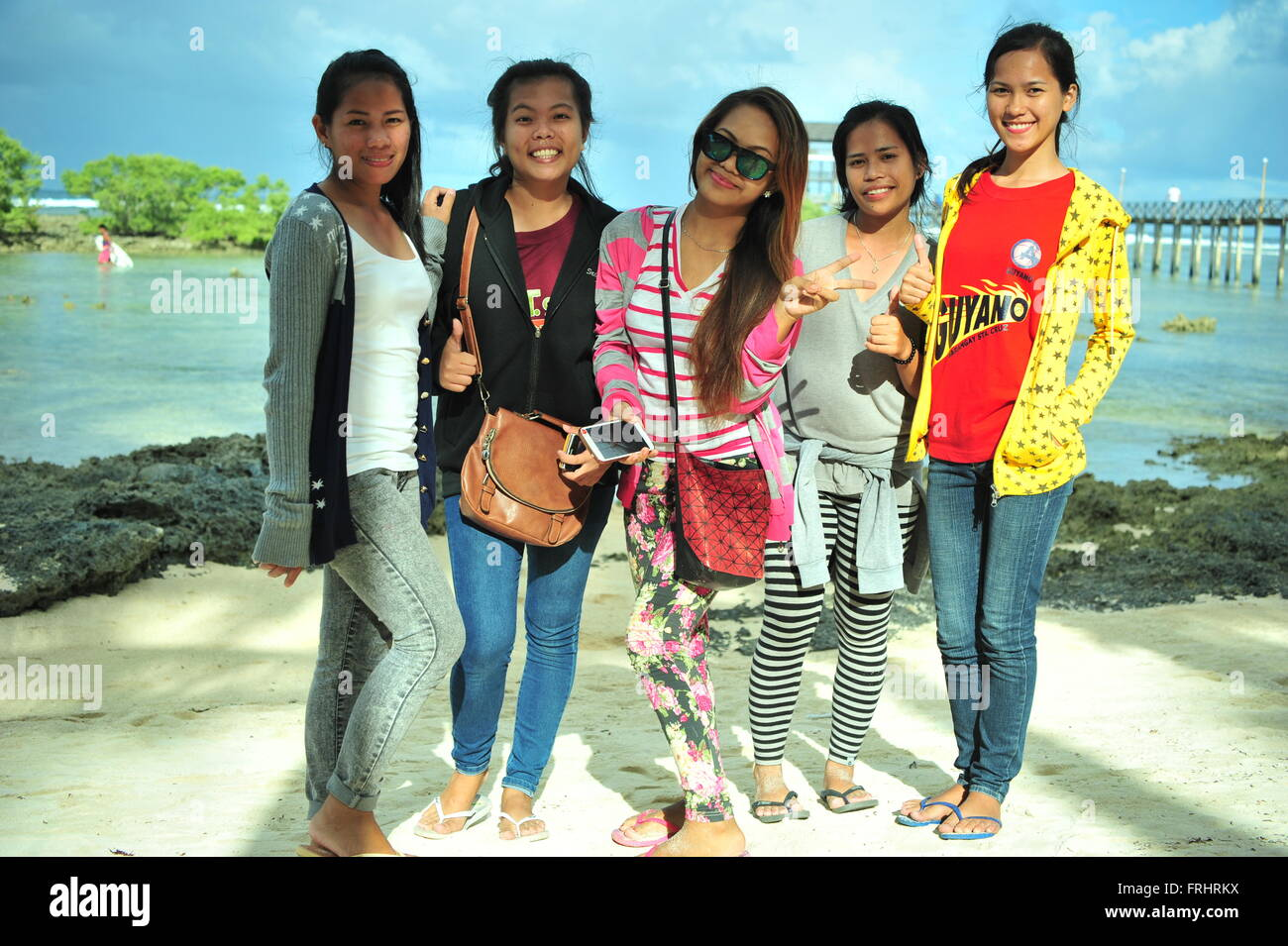 Filipinas are posing, Cloud 9, Siargao Island, Philippines. Editorial use only. - Stock Image