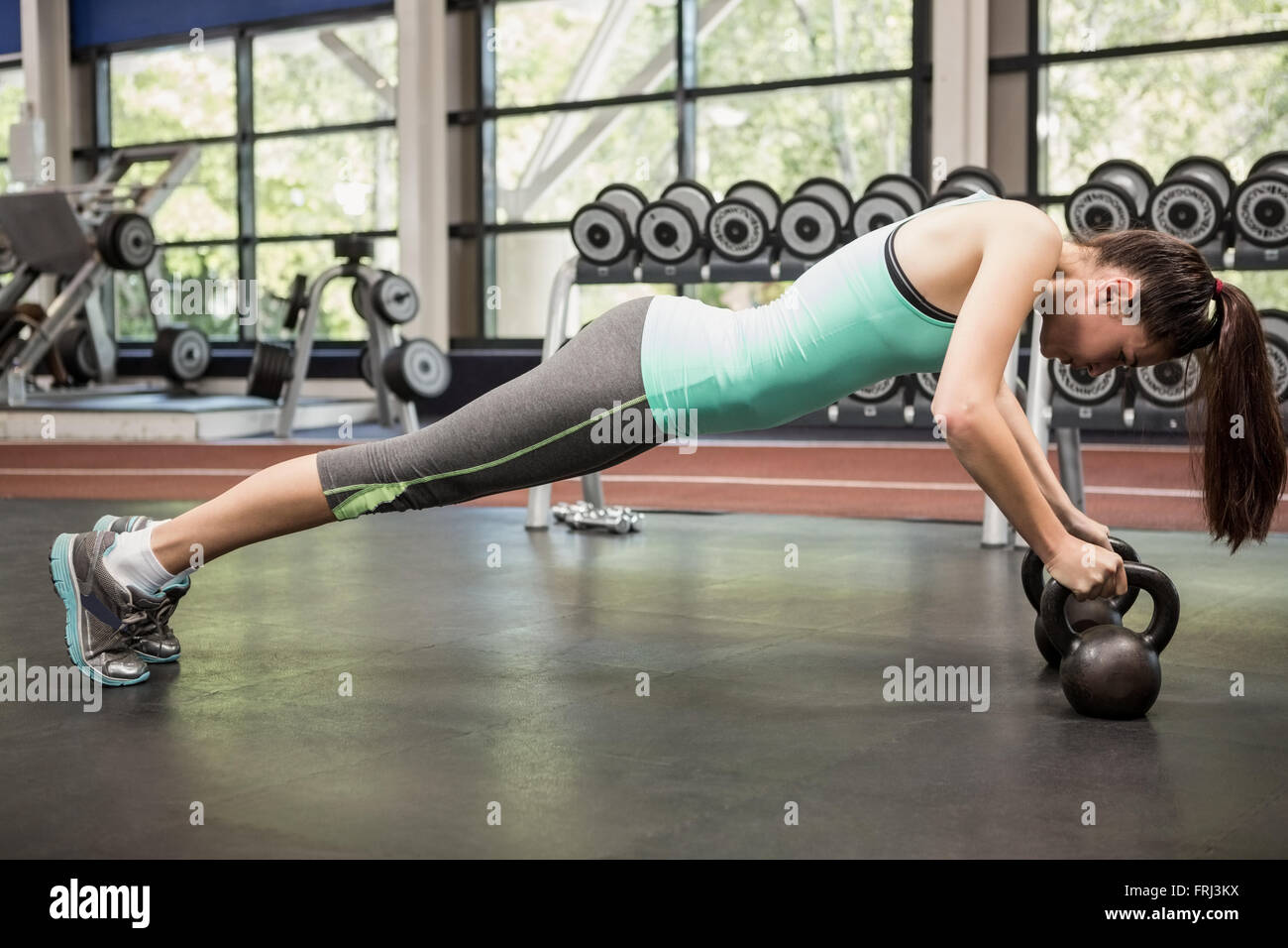 Woman working out with kettlebell - Stock Image