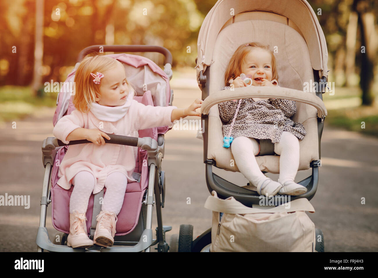 Family walk in the park - Stock Image